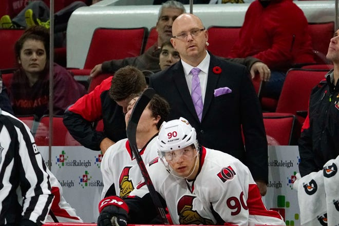 Nov 7, 2015; Raleigh, NC, USA;  Ottawa Senators assistant coach Andre Tourigny and forward Alex Chiasson (90) look on from the bench against the Carolina Hurricanes at PNC Arena. The Carolina Hurricanes defeated the Ottawa Senators 3-2 in overtime. Mandatory Credit: James Guillory-USA TODAY Sports