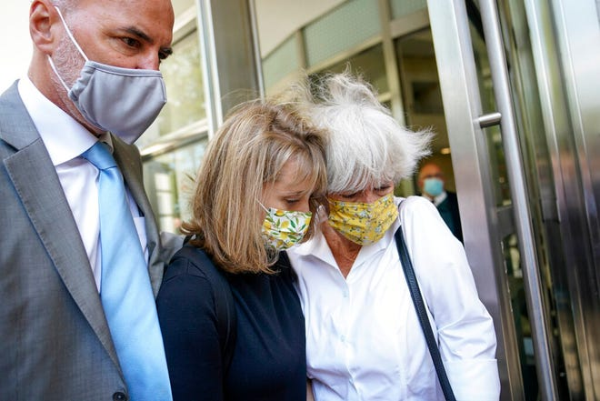 """Allison Mack, center, leaves federal court with her mother, Mindy Mack, after being sentenced, Wednesday, June 30, 2021, in New York. The """"Smallville"""" actor was sentenced to three years in prison for her role in the scandal-ridden, cult-like NXIVM group. (AP Photo/Mary Altaffer)"""