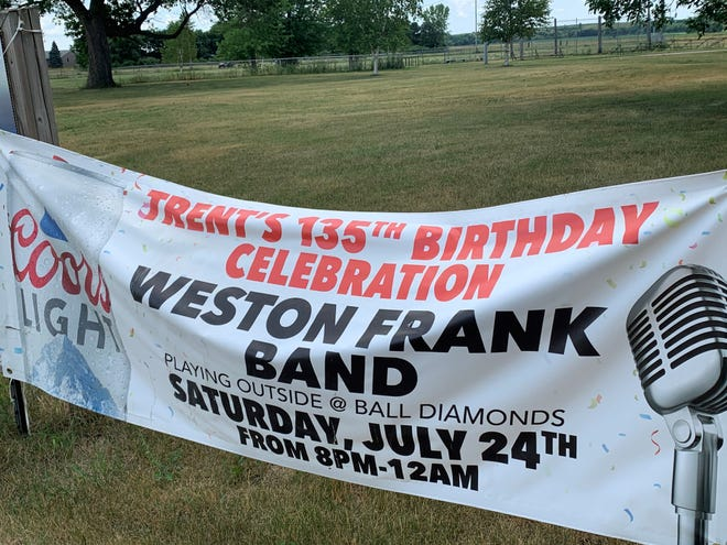 Signage on Third Street in Trent announces the town's 135th Birthday Celebration.