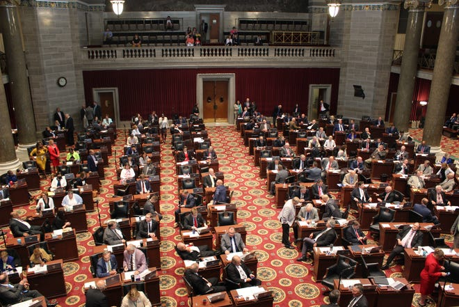 Lawmakers sit on the floor of the Missouri House of Representatives on June 30, 2021. The House passed a tax critical to funding the state's Medicaid program Wednesday.