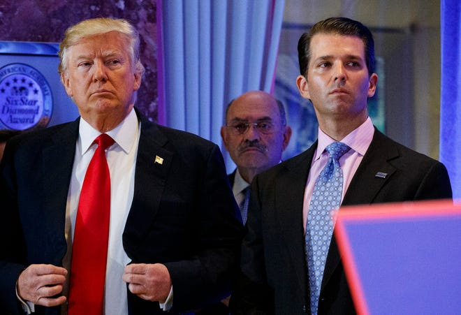 In this Jan. 11, 2017, shows President-elect Donald Trump, left, his chief financial officer Allen Weisselberg, center, and his son Donald Trump Jr., right, attend a news conference in the lobby of Trump Tower in New York. Manhattan prosecutors have informed Donald Trump's company that it could soon face criminal charges stemming from a long-running investigation into the former president's business dealings. The New York Times reported that charges could be filed against the Trump Organization as early as next week related to fringe benefits the company gave to top executives, such as use of apartments.