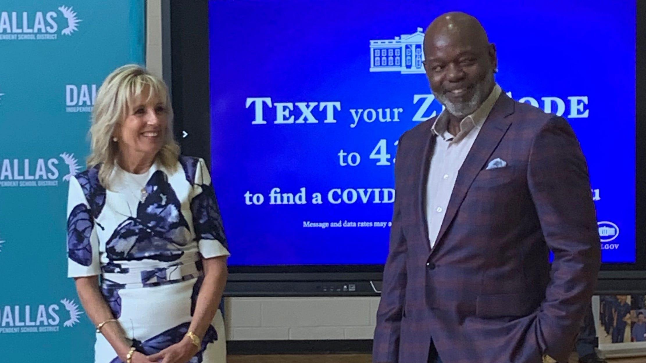 First Lady Jill Biden and Cowboys Hall of Famer Emmitt Smith talk to those assembled at Emmett J. Conrad High in Dallas.