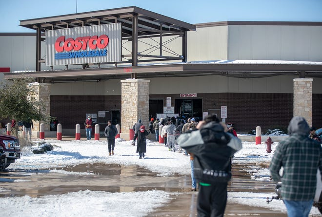 People line up to enter Costco in Pflugerville on Feb. 16 as a severe winter storm left many people without power and water.