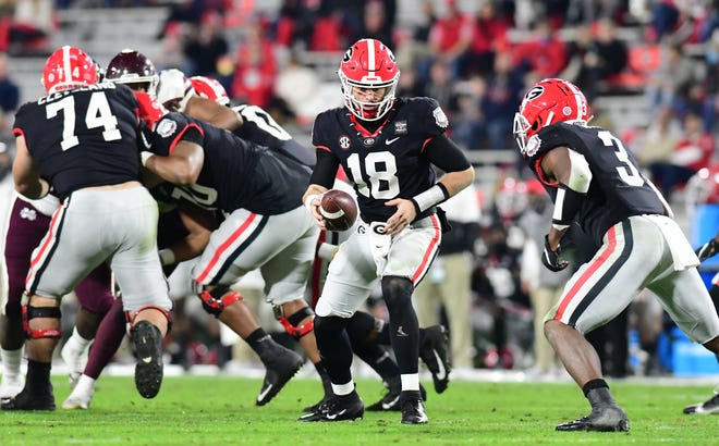 Georgia quarterback JT Daniels (18) during the Bulldogs game against Mississippi State at Dooley Field at Sanford Stadium in Athens, Ga., on Saturday, Nov. 21, 2020. (Photo by Perry McIntyre)