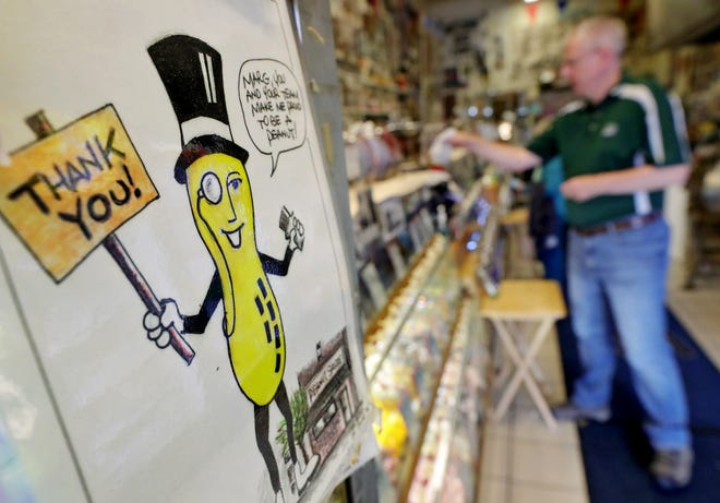 A drawing of Mr. Peanut appears to thank customers as they shop at The Peanut Shoppe Thursday in downtown Akron.