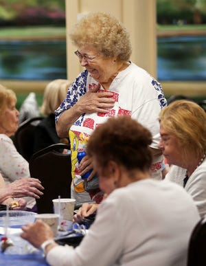 Judy Johnson of Sagamore Hills shares a laugh with a group of friends during a senior lunch and bingo gathering in the senior center at Macedonia City Hall last week. Thursday was the group's first gathering since pandemic closure.