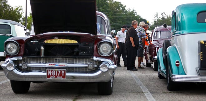 Car enthusiasts check out the classic cars during a cruise in at Firehouse Grill and Pub last week. The events are held on Tuesdays from 5 to 8 p.m. at the restaurant at 10 Tallmadge Circle.