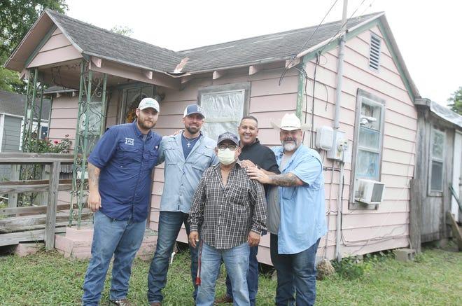 Homeowner Juan Manrique and Veterans Service Officer David Salinas Jr. met with contractors from RoofTop 101 to fix Manrique's roof. Pictured (LtoR) Back Row: Marc Rueda, Michael Landwert, David Salinas Jr. and Paul Rueda. Front Row: Juan Manrique
