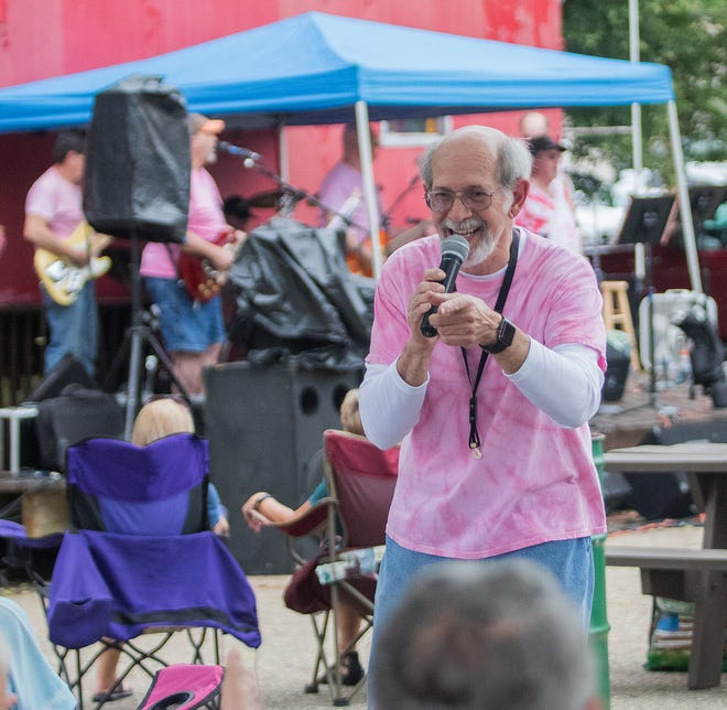 Band leader John Hampu works the crowd Friday, June 25, 2021, while performing with his John Hampu Band in the downtown Alliance Caboose parking lot.