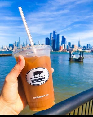 Order cold brews, nitro coffee and iced lattes at Cowabunga Coffee Roasters in Warrington.