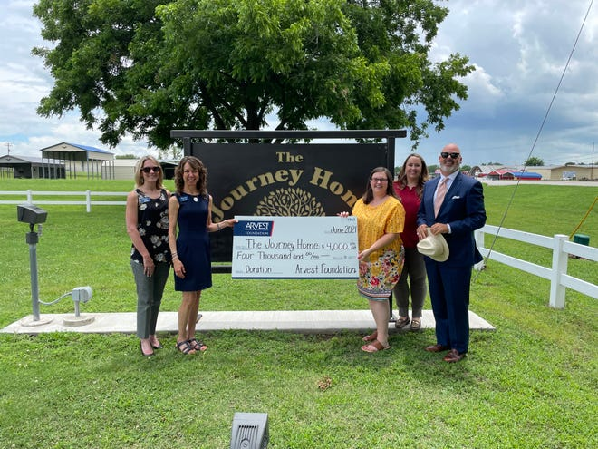 Arvest Bank mortgage manager Sonya Reed, marketing manager Stevie Williams and Arvest Wealth Management client advisor Suzanne Duhon presented the check to Brennen Bissinger, executive director of The Journey Home, along with board member Scott Holz.
