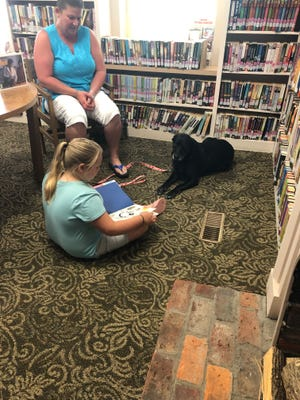 Suzanne Munchy, owner of Princess, a therapy dog from St. Clairsviile,both visited Clark Memorial Branch Library in Freeportfor summer reading 2021.Children got to read to the dog during their visit to the library.