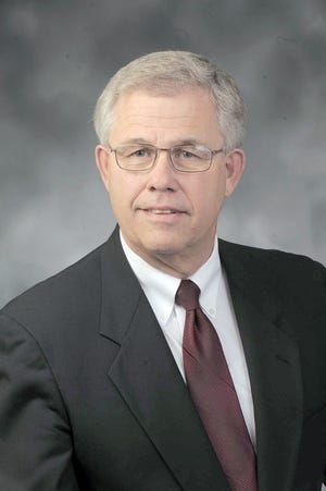 """Dave Muntzel, who served as the 48th District Missouri House State Representative the past 8 years, has now authored a newly released book entitled, """"Light Side""""."""