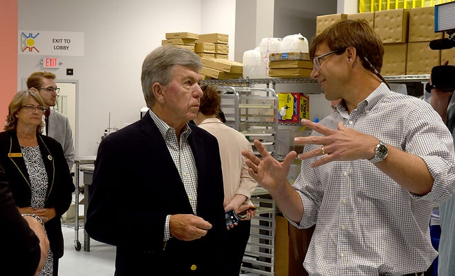 Sen. Roy Blunt, left, listens to ThermAvant Technologies co-founder and CEO Joe Boswell during a tour of the ThermAvant Technologies plant on Thursday prior to a roundtable discussion with state, county and city leaders.