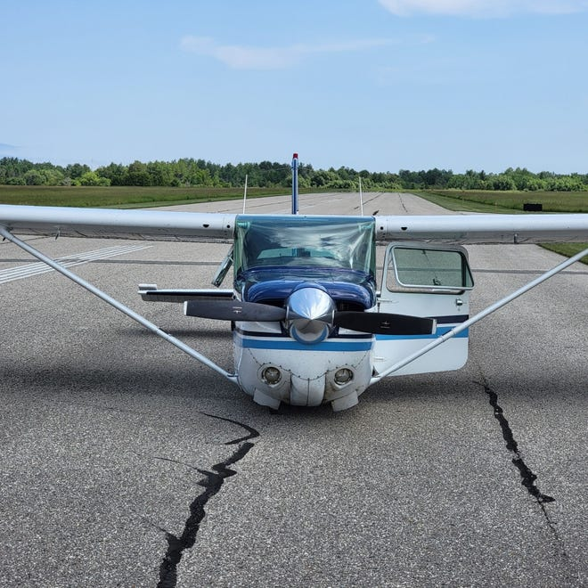 A pilot did not put his landing gear down as he was approaching the Cheboygan County Airport from the west, causing him to crash his plane on the runway at the airport.