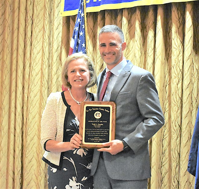"""Yates County DA Todd Casella receiving the """"2021 Prosecutor of the Year"""" award June 26 from Susan Valle, Director of NYPTI, at a conference in Lake George."""