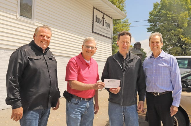 Greg Hughes (second from left), pastor of the House of Prayer church and ministry in Chillicothe, accepts a donation check from members of the veteran group of organizers of the non-denominational Laymen's Pre-Easter Services conducted prior to the work day in Chillicothe each year for many years. The funds are generated by free-will donations made at the services each morning. Representing the laymen's organization are, from left, Don Boswell, Darrell Rinehart, Jr. and David Neal.