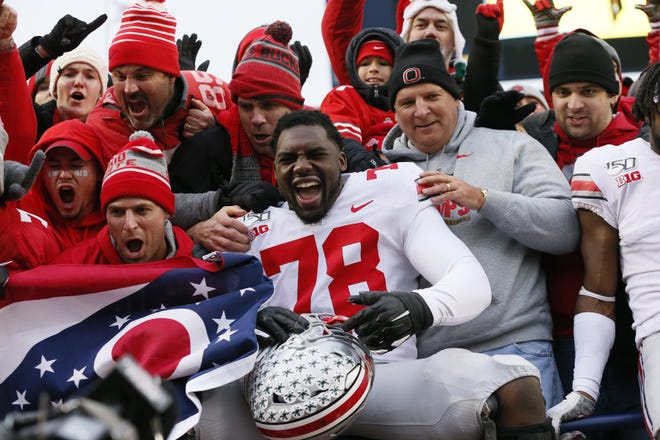 Ohio State tackle Nicholas Petit-Frere, here celebrating with fans after a win over Michigan in 2019, will serve as a public spokesman for a Tampa technology startup.