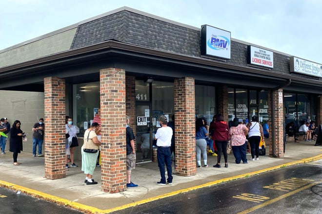 Customers are lined up around the corner at the Ohio Bureau of Motor Vehicles location on Agler Road in Gahanna Thursday.