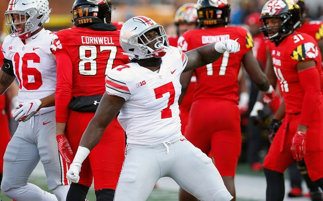 Ohio State Buckeyes linebacker Teradja Mitchell (7) celebrates his tackle of Maryland Terrapins running back Javon Leake (20) in the second half of their game at Maryland Stadium in College Park, MD on November 17, 2018. [ Brooke LaValley / Dispatch ]