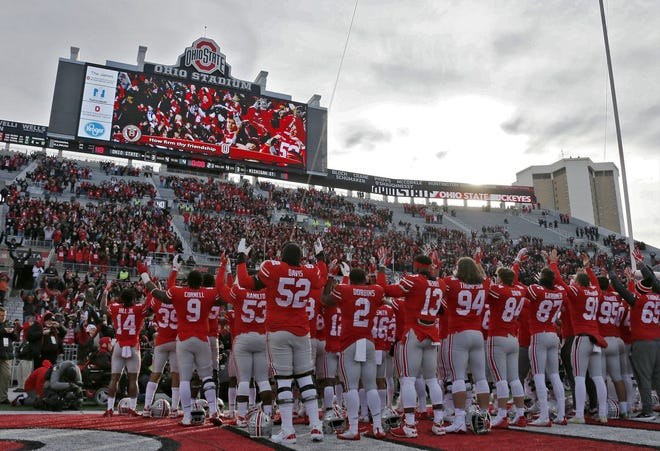 """The Ohio State Buckeyes sing """"Carmen Ohio"""" following a 48-3 win over the Michigan State Spartans during Saturday's NCAA Division I football game at Ohio Stadium in Columbus on November 11, 2017. [Barbara J. Perenic/Dispatch]"""