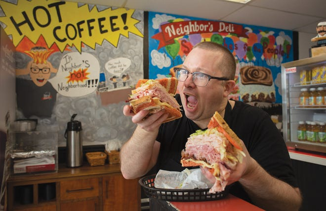 Jon Snyder with a Country Club sandwich at Neighbor's Deli