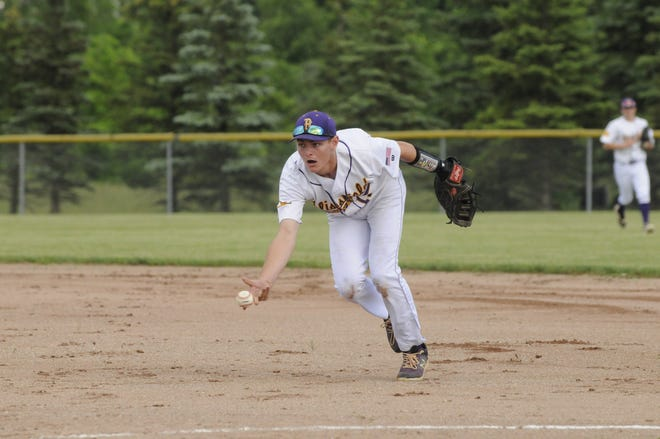 Blissfield's Scott Jackson (11) flips the ball to first for an out during a game against Manchester on June 9.