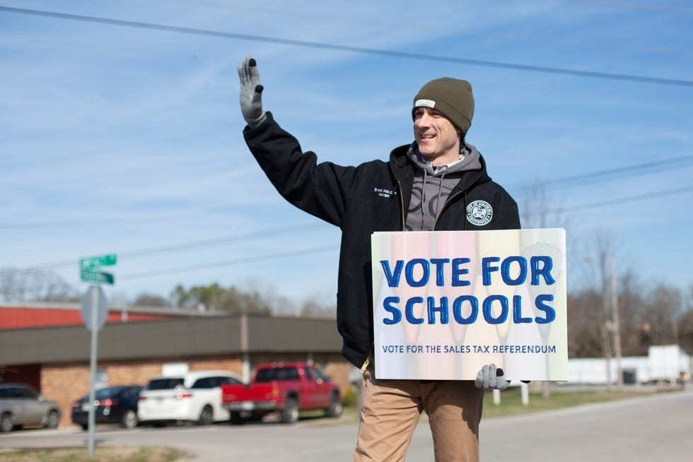 Columbia Mayor Chaz Molder pickets in support of a proposed sales tax increase, benefitting the local school district in front of the Maury County Election Commission on Saturday, Feb. 22, 2020.