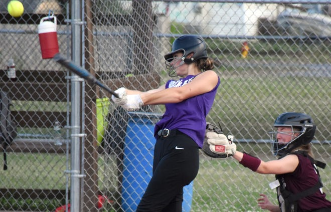Makenna Tooley from Little Falls hits the ball for Klutch Performance Tuesday during the opening night of play in the Whalen Park High School Fastpitch Softball League.
