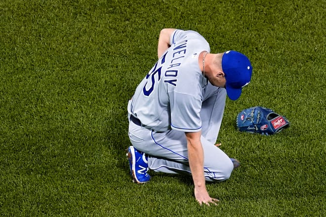 Kansas City Royals relief pitcher Richard Lovelady reacts after being struck by a hit by Boston Red Sox's J.D. Martinez during the seventh inning of Wednesday's game at Fenway Park in Boston. Lovelady left the game but manager Mike Matheny said he did not suffer any broken ribs or internal injuries.