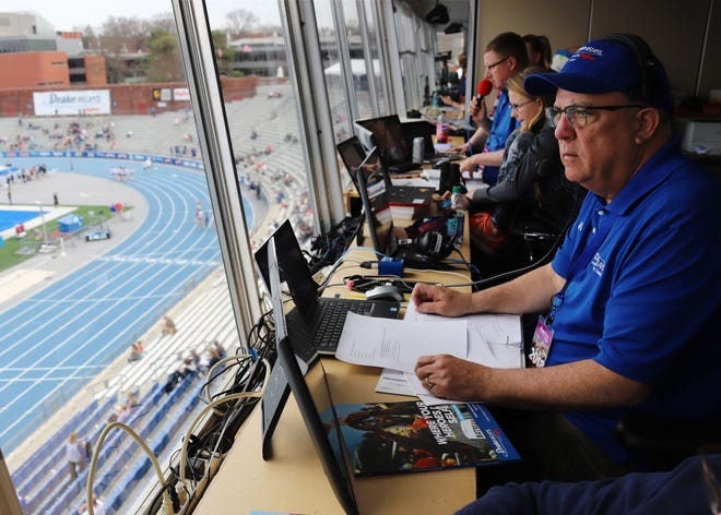Mike Jay, of Columbus Junction, is at home on the mic as the voice of the Drake Relays calling the action on the blue oval from his perch in the announcer booth April 26, 2018, in Des Moines.