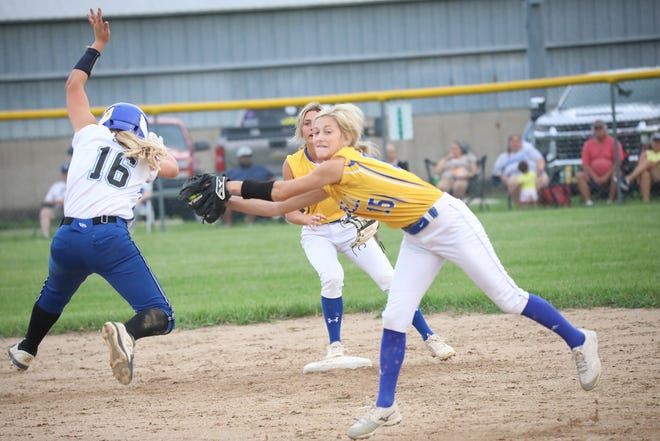 Wapello second baseman Sammi Ewart reaches out to tag Columbus' Lily Coil who maneuvers to avoid the tag Wednesday at Columbus Junction.