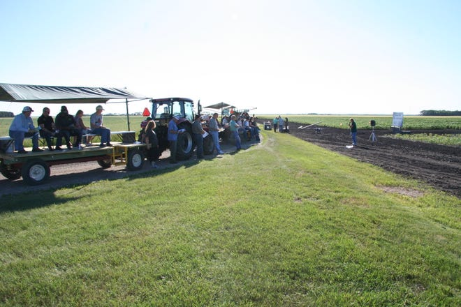 Visitors attend a field tour at NDSU's Agronomy Seed Farm.