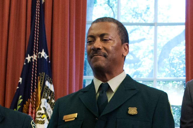 In this July 10, 2015, file photo Randy Moore, of the U.S. Forest Service, listens as President Barack Obama talks about the designation of three new national monuments in the Oval Office of the White House in Washington.