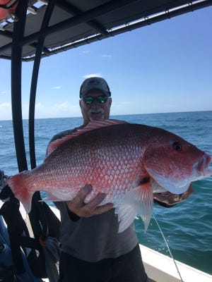 Capt. Kirk Waltz with a jumbo red snapper, a common catch off the coast of Northeast Florida. This year's snapper season runs from July 8 to July 10.