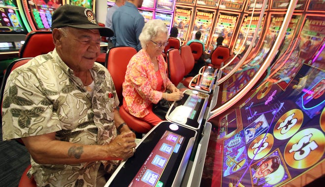 Lonnie and Barbara Locklear try their luck after the ribbon cutting ceremony for the Catawba Two Kings Casino pre-launch facility Thursday morning, July 1, 2021.
