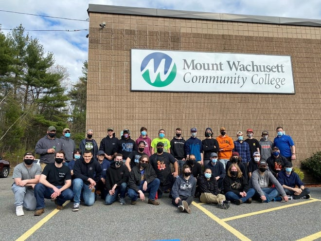 Mount Wachusett Community College automotive students and alumni recently are shown at the Linus Allain Avenue facility in Gardner.