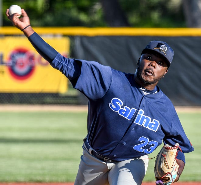 The Salina Stockade's Mario Alston delivers a pitch against the Garden Cty Wind on June 2 at Clint Lightner Field in Garden City. The Stockade announced Tuesday that they will not play any home games in Salina this season, with those games being played in Colby.