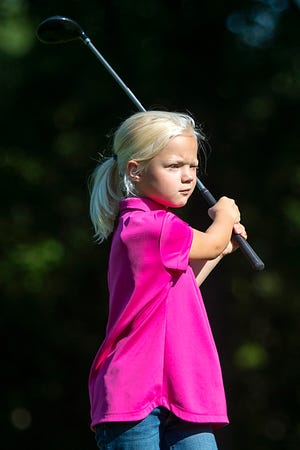 Naomi Van Unnik of Knoxville keeps an eye on her tee shot as she competes in the Girls 7-9 division of the Drive, Chip and Putt qualifying event at Lake Bracken on Thursday, July 1, 2021.