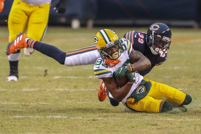 Green Bay Packers wide receiver Marquez Valdes-Scantling (83) is tackled by Chicago Bears free safety Eddie Jackson (39) during the first half of a game on Sunday, Jan. 3, 2021, in Chicago.