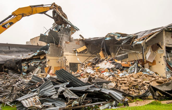 Construction crews work on tearing down Tri-North Middle School on Thursday, July 1, 2021. The new building is taking shape next door and will open for the 2021-22 school year. The site of the former Tri-North building will become a football practice field with a track around it.