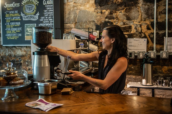 Angela Brickhouse works behind the bar of Main Street Coffee, which is partnering with D9 Brewery and recently opened in downtown Hendersonville.