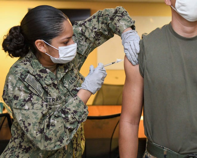 U.S. Navy HN Denisse Estrada-Suarez administers the Pfizer COVID-19 vaccine during a Naval Medical Center Camp Lejeune COVID-19 Vaccine Tiger Team visit to Marine Forces Special Operations Command, June 15, 2021. The Tiger Teams transport vaccines to distant parts of base to increase accessibility.