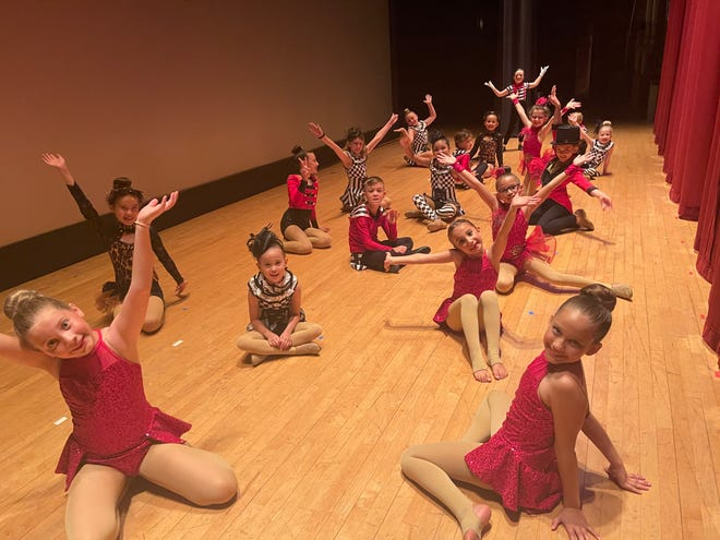 Dancers with Lejeune Dance Company pose for a photo at a past recital.
