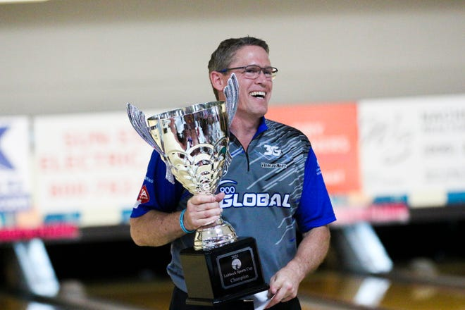Hall of Fame bowler Chris Barnes cradles the trophy after winning the PBA50 Cup -- a seniors tour major championship -- on Wednesday night at South Plains. The win was the first on the PBA50 for Barnes. He has won 19 times on the PBA Tour, on which he is still a full-time player.