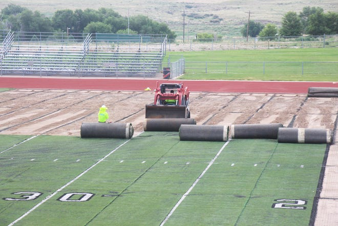 Workers from Hellas Construction remove the old artificial surface from Tiger Stadium on Thursday, July 1, 2021. Work began on the removal of the old turf, which was installed in 2010, on Wednesday, June 30, 2021. Work on installing a new turf will begin next week and the project is expected to be completed on Aug. 1, 2021.