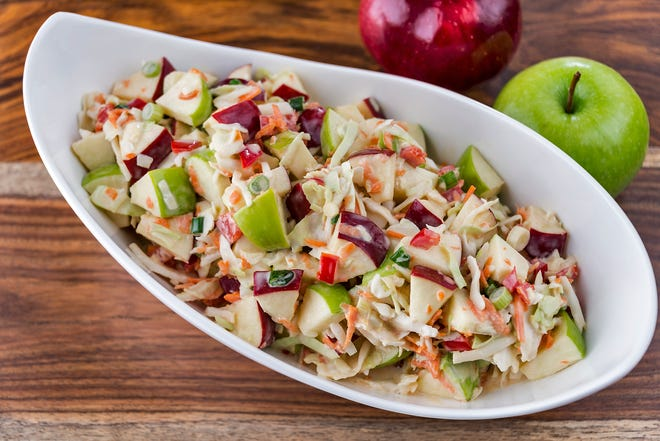 A bowl of fresh-made coleslaw with green apples.