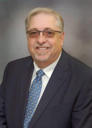 Mark E. Rector