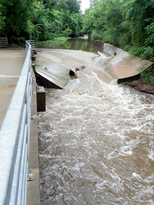 A portion of the Three-Mile Creek trail in downtown Leavenworth is under water following heavy rain.