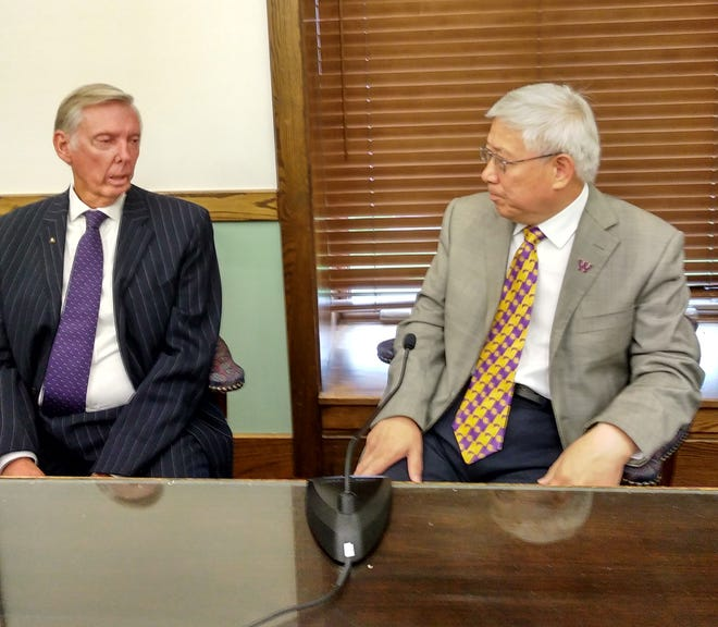 """Gordy Taylor (left) interviews WIU President Guiyou Huang for the cable television series """"Macomb on the Move."""""""